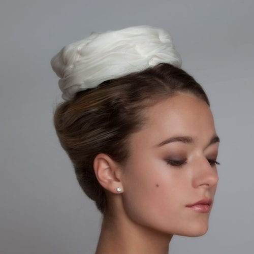 woman with silk bridal pillbox hat