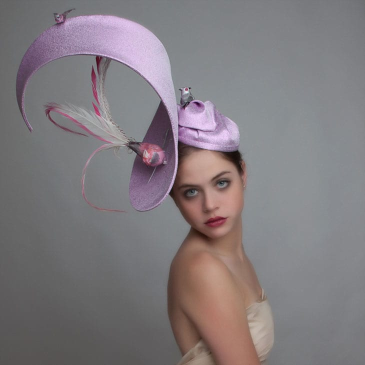 woman in couture hat