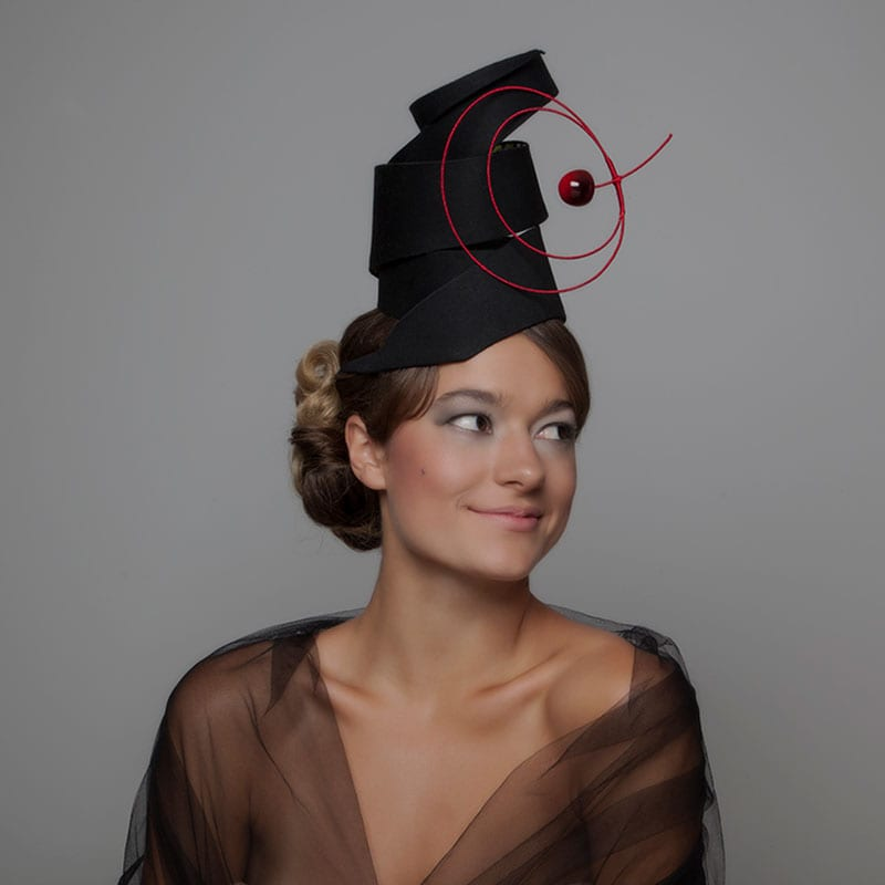 woman in cherry hat